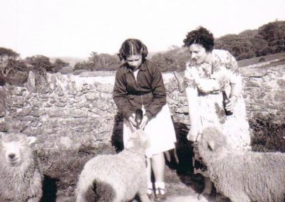 Dawn Kelland nee Gorden and her mother feeding lambs