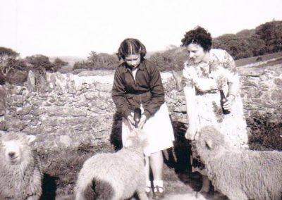 Dawn Kelland nee Gorden and her mother feeding lambs