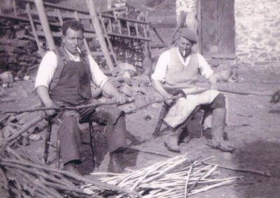 Lewis Sanders  and Harry Trant making spears (sparrow sticks) for thatching ricks.