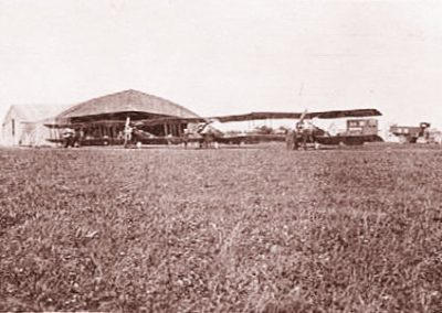 East Prawle Airfield with. Sopwith 1 1/2 strutters with hangers in background WWI