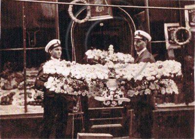 Royal Naval Air Service. RAF flower aeroplane held by two people WWI