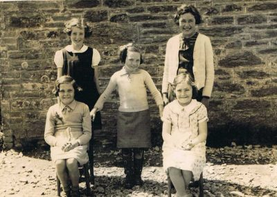 Jean Black, Betty Logan, Margaret Login, Phyllis Partridge, Alice Stone, Girl Guides/Brownies taken at Prawle School, approx 1939