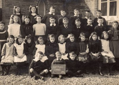 East Prawle School: 2nd row no 5 William Albert Partridge, no 8 Bert Stone, front row no 8 Dorothy Tucker, no 9 Mary Blanche Tucker, 1912