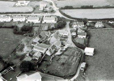 Aerial view of East Prawle with council houses in the background and Coolings and Town Farm 1972-73