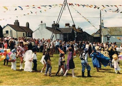Prawle Fair, dancing round may pole on Prawle green; children were walked round in fancy dress and then paraded while judging took place, 1970s