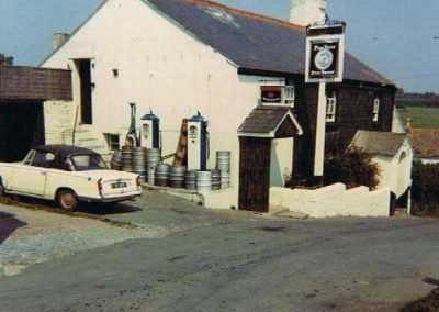 Pigs Nose petrol pumps with a Triumph Herald parked (Sue Ireland's)