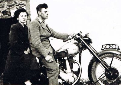 Jean Wotton (Harold Hannaford's wife) and her brother Richard on motorbike BSA 350cc model B31, number plate JOD-386