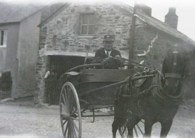Postie Jim outside the blacksmith's late 1920s