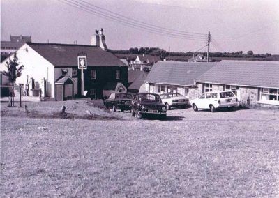 Pig's Nose Inn (petrol pumps) and Piglet stores. East Prawle green, 1960s or 1970s, Cars K registrations