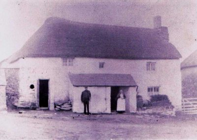 Albert Rundle and his mother outside Fuschia Cottage (now known as Providence Cottage) pre 1935