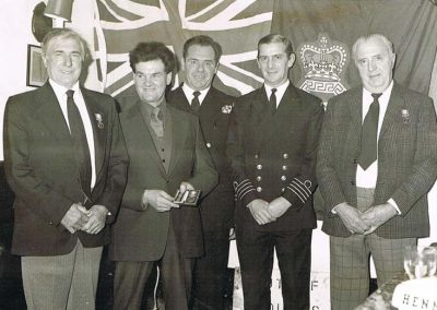 Coastguards, left to right: Bill Blank, Michael Partridge, Jack Appleton- station officer, not known, Jack Rendle. 1970s