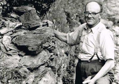John Francis Tucker building a dry stone wall at Sharpers House about 1972 (born 14 March 1912)