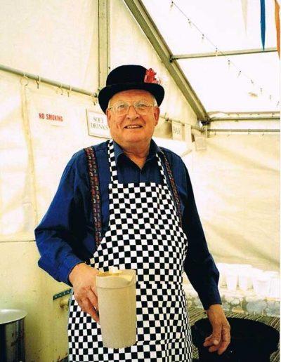 Steve Mitchelmore in bowler hat making tea, Prawle Fair 2002