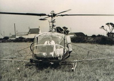 Dorothy May Tripp just landing from helicopter August 1959