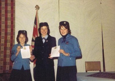 Girl Guides Queen's Guide Award Pigs Nose Hall: Sarah Trinick, Jane Higgins with Jeannette Haddy in middle, 1980