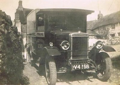 WE Tucker's van outside Mrs Ford's taken 2-5-1920 or 1930 not sure