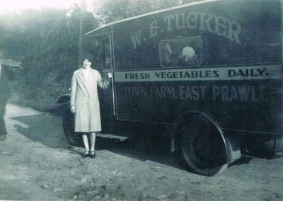 W E Tucker van with the label Town Farm East Prawle, Freda Caudell, Manageress of Tucker's shop Dartmouth, standing by (Roger Tucker's godmother)