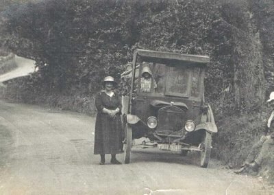 Frances Ann and William Ernest Tucker (Granny and Granfer) at Blackpool Sands, with unknown child in automobile; note the road; Model T Ford made into a pickup truck