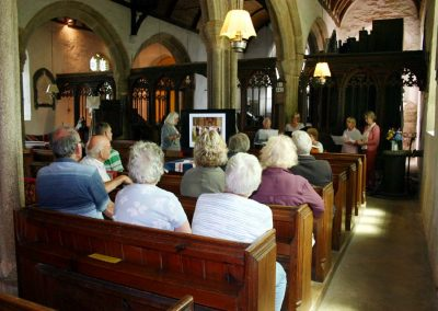 St Sylvester's Church listening to the choir and watching video of weddings