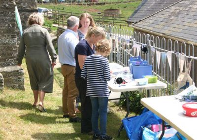 Open Day Nicky Bailey (AONB) helping children create spiders