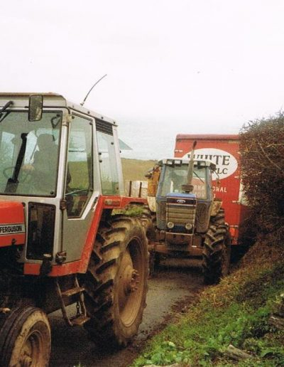 Two tractors pulling the removal van moving Sarah Trinick back to East Prawle from Hong Kong