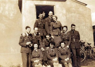 Group of uniformed people. RAF camp when it was first built before they tarred and used hessian bagging to make it waterproof WWII