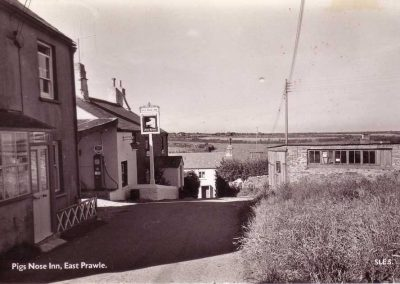Sunnyside Cottage and Pigs Nose Inn with petrol pumps. Also down Penny Hill and the shop before the upper floor added