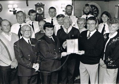 Coastguard group presenting certificate, 25 years of service