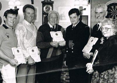 Adrian Wotton, Richard Partridge, Don Rackham, Coastguard officer, Mr Reid, unknown, Norah Kingston  receiving certificates Rocket apparatus