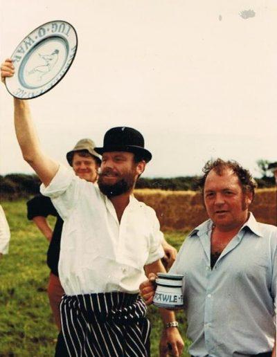Prawle Fair John Ireland holding theTug-of-War trophy, Johnny Morris, 1970s