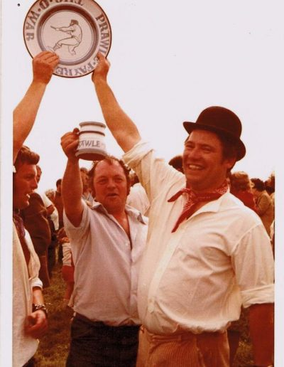 Prawle Fair Jim Bailey and Johnny Morris holding up the Tug-of-War plate and the Tug-of-War mug 1970s