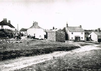 East Prawle Green with first car belonging to Dr Webster and stones on the green for the road, and building on the green