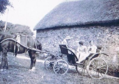 Margaret Partridge on right with two visitors in Town Meadow, Coolings Farm, mid 1920s