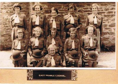 East Prawle C School girl guides school group. Back row left to right: Unknown, Jean Trute, Patsy Putt, Unknown, Toby Login; Middle row: Jean Black (coastguard's daughter) Barbara Partridge, Queenie Weymouth, Elsie Login? Rita Rundle; Front row: Nancy Login 1937