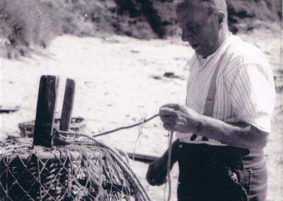 Frank Login with a crab pot, Ivy Cove, around 1945