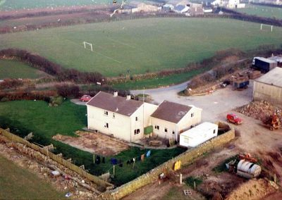 Aerial view Higher House Farm with washing and football pitch, Easter 1991