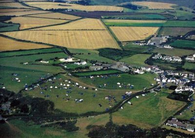 Aerial view camping behind Higher Farm and on the way down to Ash Park. 27 August 2003. Lots of tents and caravans