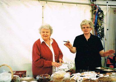 Prawle Fair, Josephine Trinick and Norah Kingston selling cakes,  2002