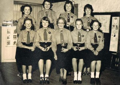 Girl Guides: Back Gladys Tucker, Brenda Blank, Hazel Blank, Dawn Gordon, Front Elizabeth Baker, Gillian Easterbrook, Mrs Relle, Cheryl Pressley, Betty Tucker, 1950s