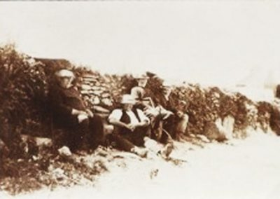 William Putt, Albert Rundle, Robert A Phillips, Danny Wotton sitting by the wall at the top of East Prawle Village Green
