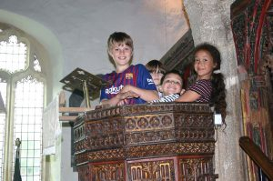 Children in the medieval pulpit on Open Day 21 July 2019