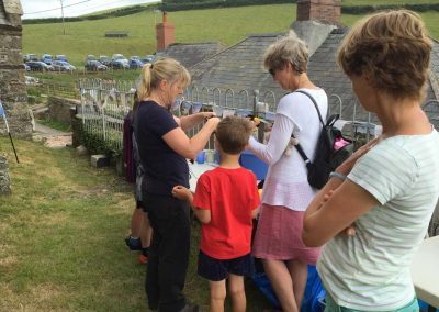 Nicky Bailey (AONB) helping design spiders and bees