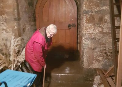 Vicky Tucker clearing water in the room below the bell ringing chamber
