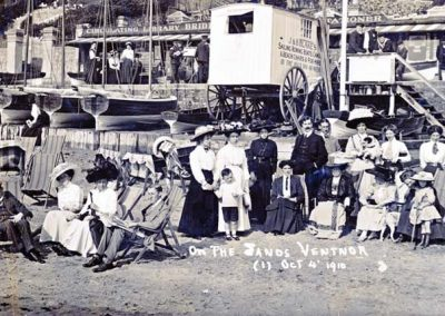 A Postcard showing Ventnor Beach, IOW on 4th October 1910. The Postcard is from Mary Ann (Annie) Phillips Hutchings to her niece, Eva Melita Jane Eastman (Melita) who is staying either at Gurnard or Plumstead. One of the ladies in the postcard photo is Annie and she challenges Melita to find her.