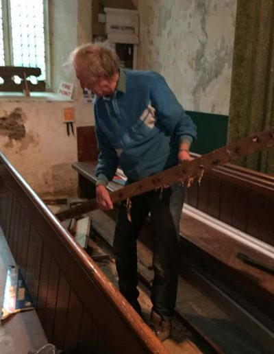 Starting to remove the pews from the back of the Church