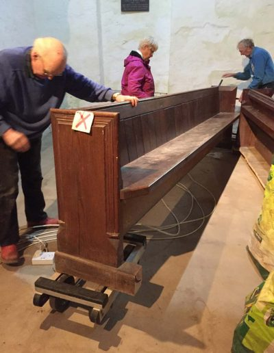 Removing the pews from the back of the Church
