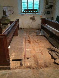 Starting to remove pews from the back of the Church