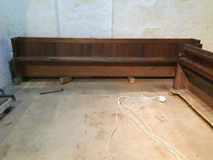 Removal of the pews from the back of the Church