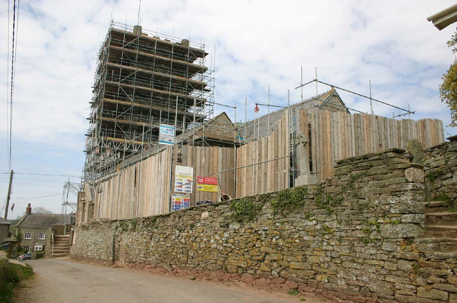 Scaffolded St Sylvester's Church from road
